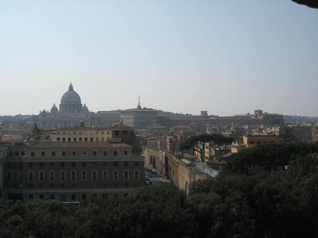 From the top of Castel Sant'Angelo, the dome of St. Peter's Basilica stands against the skyline.